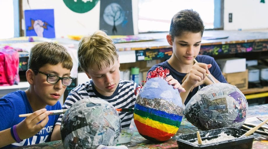 Boys making paper mache scultpure