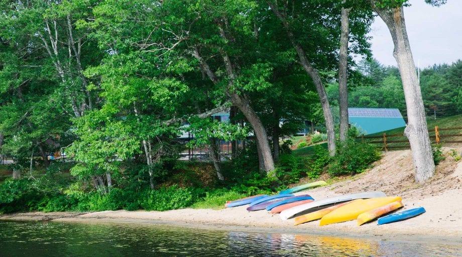 Kayaks and canoes by lake