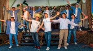 Boys wearing straw hats and blue jeans in theater performance