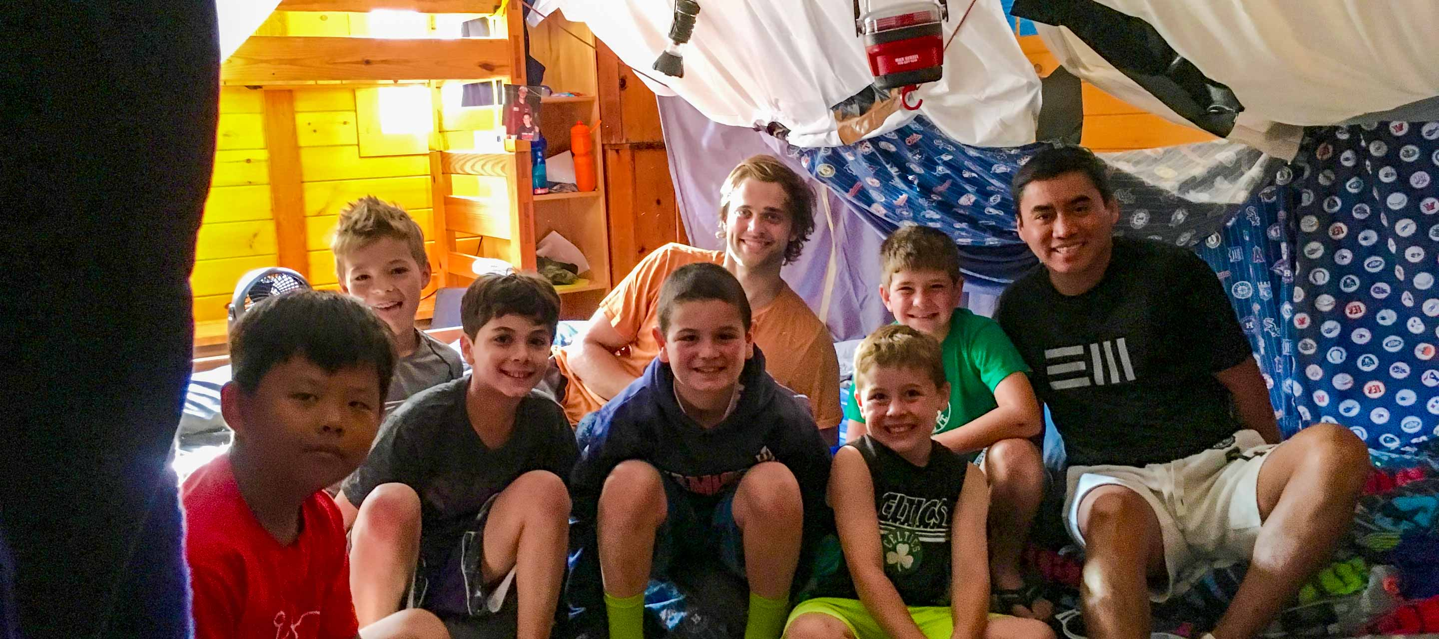 Boys in bunk under a fort