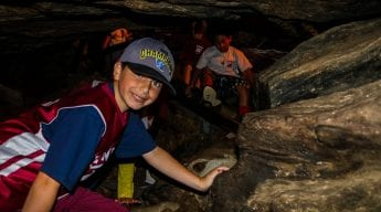 Boys exploring dark caves