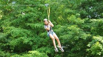 Female camper on zipline