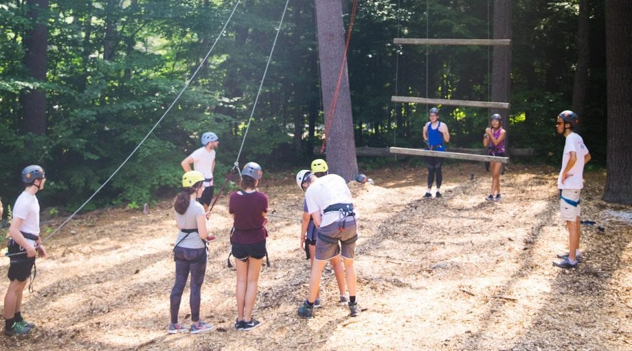 Campers on high ropes course belaying