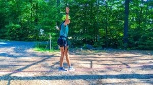 Camper learning to slackline