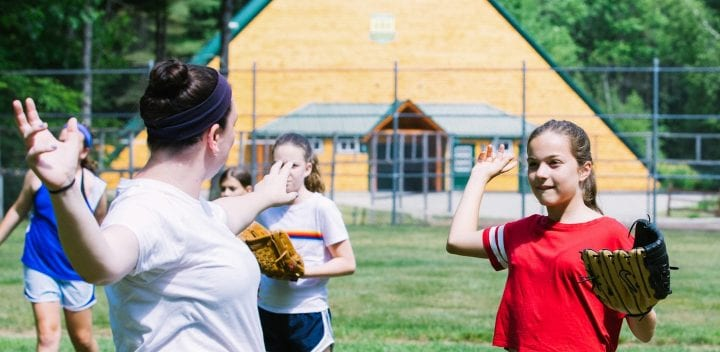 Two girls playing softball