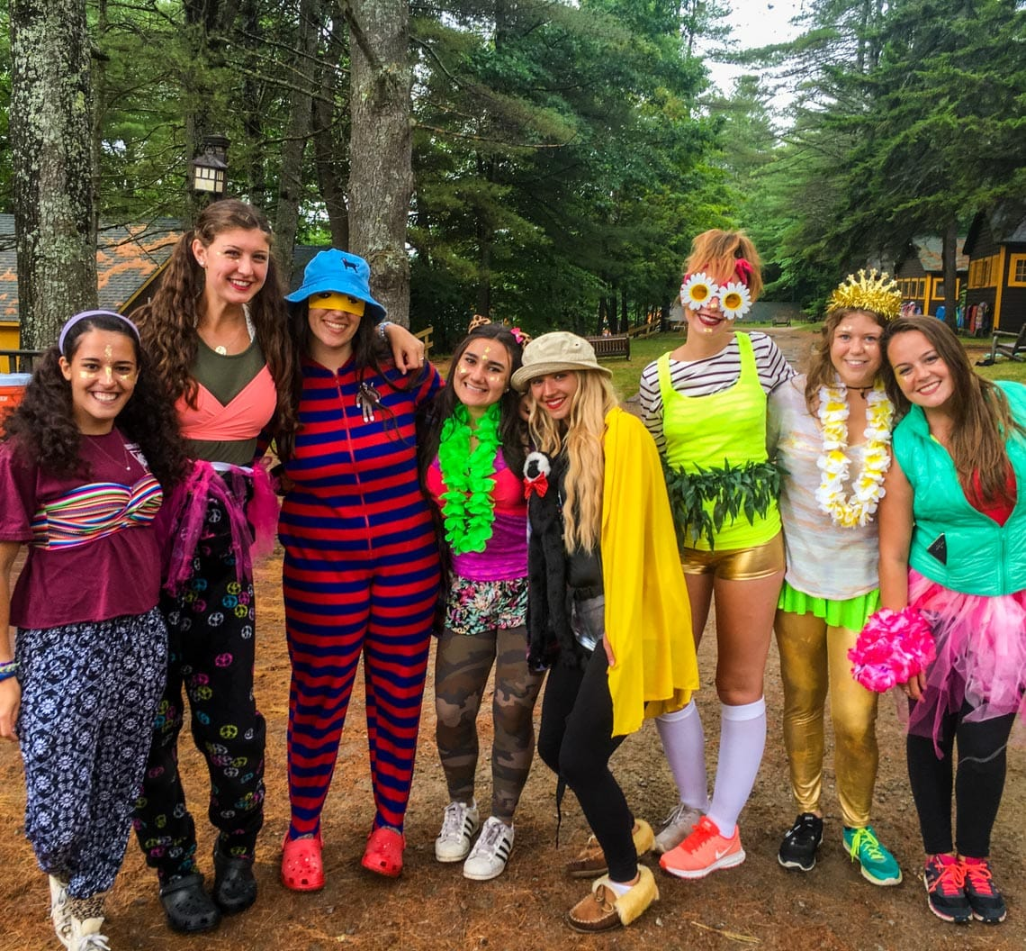 Campers in costume for special event smiling