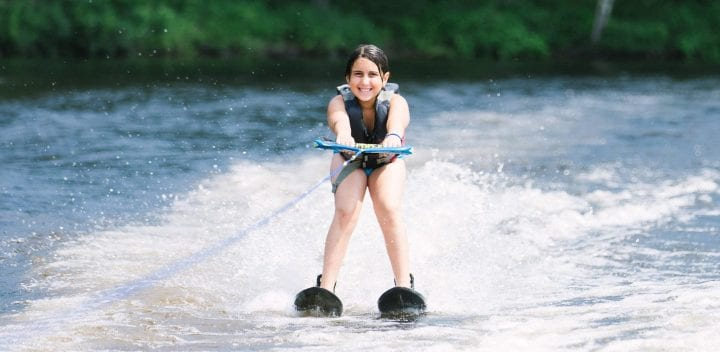 Girl waterskiing on lake