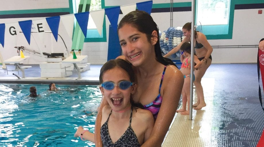 Big sisters by indoor swimming pool