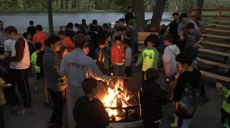 Campers attending a campfire during Rookie Day