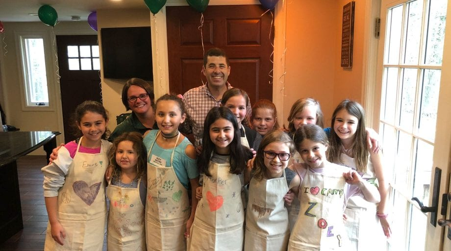 Staff with campers wearing aprons