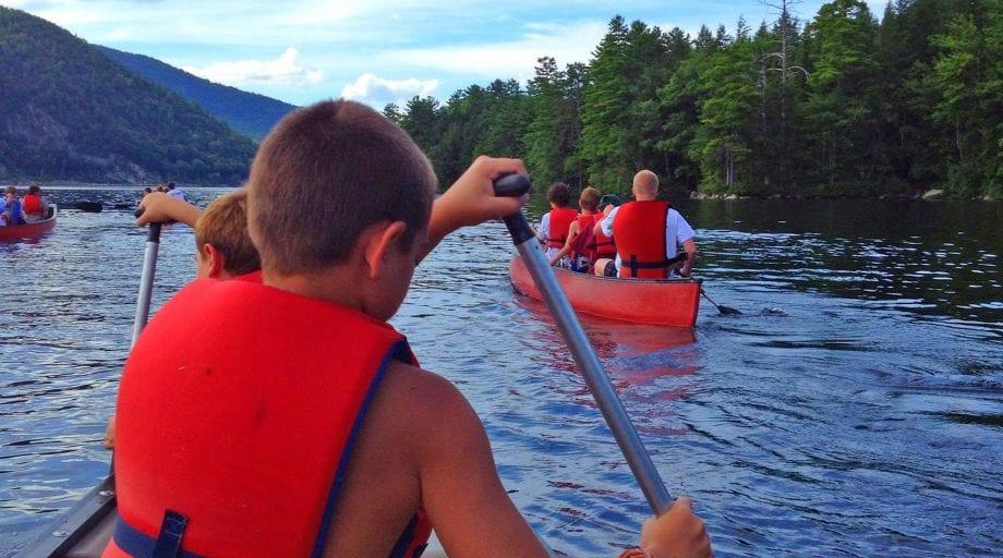 Kenwood camper canoeing on lake