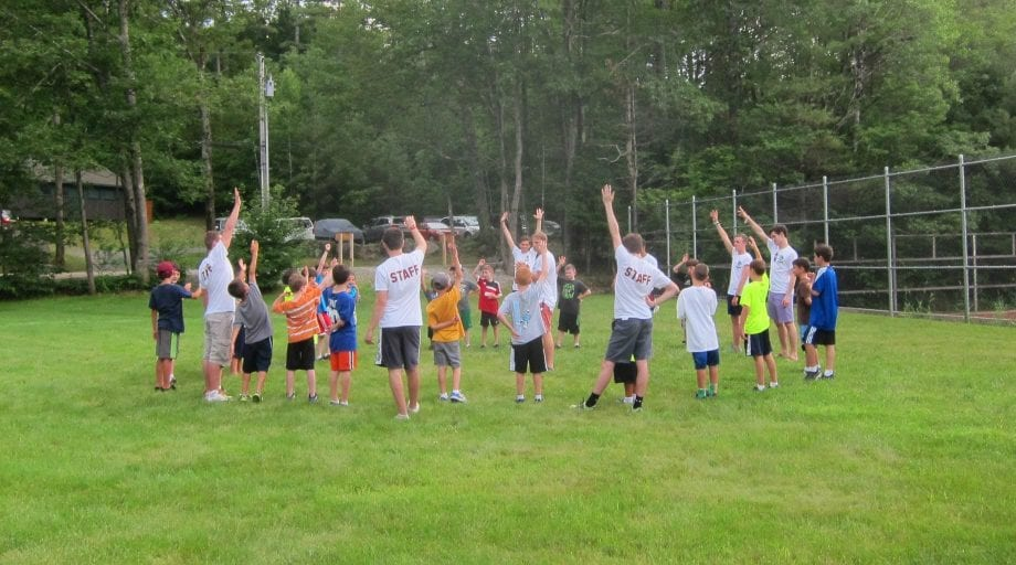 Kenwood campers in a circle doing exercises