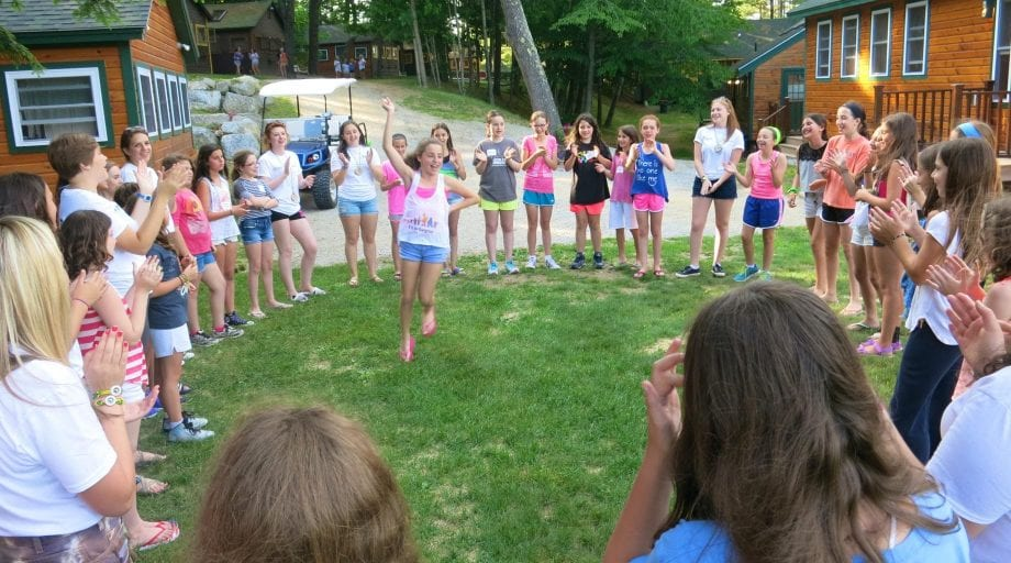 Dancing in a circle during the first day of camp