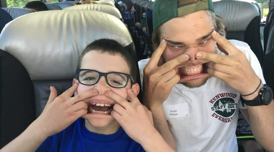Campers making silly faces on the bus